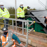 Topping out ceremony on innovative Powys Council social housing development